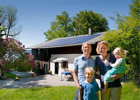 solar power - Family at home with solar panel Stock Photo - Premium Royalty-Free, Code: 649-03883523