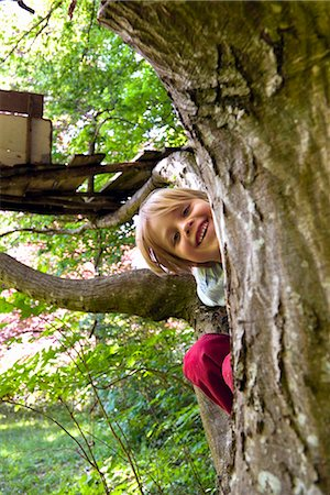 Boy climbing in tree house Stock Photo - Premium Royalty-Free, Code: 649-03883538