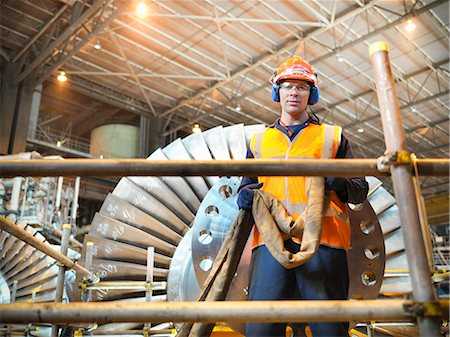Worker with turbine in power station Stock Photo - Premium Royalty-Free, Code: 649-03883726