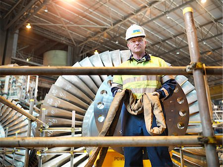 Worker with turbine in power station Stock Photo - Premium Royalty-Free, Code: 649-03883727