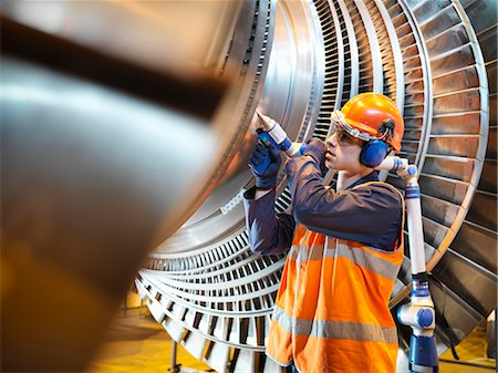 Worker inspects turbine in power station Stock Photo - Premium Royalty-Free, Code: 649-03883729