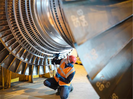 Worker inspects turbine in power station Stock Photo - Premium Royalty-Free, Code: 649-03883722