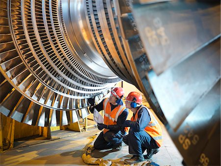 Workers inspect turbine in power station Stock Photo - Premium Royalty-Free, Code: 649-03883723