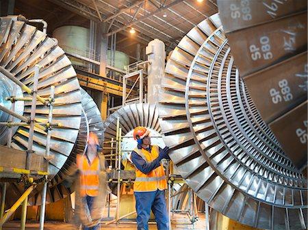 Workers with turbines in power station Stock Photo - Premium Royalty-Free, Code: 649-03883735