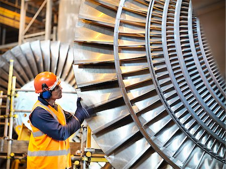 equipment - Worker inspects turbine in power station Stock Photo - Premium Royalty-Free, Code: 649-03883736