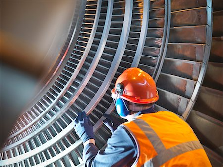 focus on background - Worker inspects turbine in power station Stock Photo - Premium Royalty-Free, Code: 649-03883731
