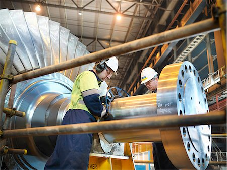 Workers inspect turbine in power station Stock Photo - Premium Royalty-Free, Code: 649-03883733