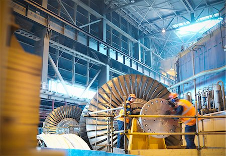 Workers inspect turbine in power station Stock Photo - Premium Royalty-Free, Code: 649-03883744