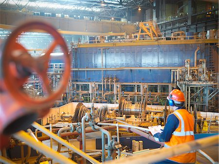 Worker with turbines in power station Stock Photo - Premium Royalty-Free, Code: 649-03883747