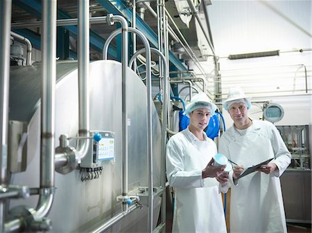 food processing plant - Workers inspecting goat yogurt in dairy Stock Photo - Premium Royalty-Free, Code: 649-03883765