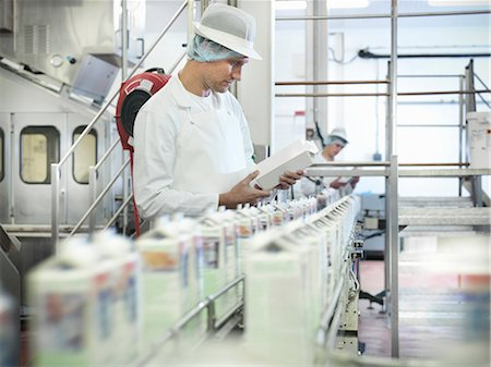 food processing plant - Worker inspecting goat's milk in dairy Stock Photo - Premium Royalty-Free, Code: 649-03883767