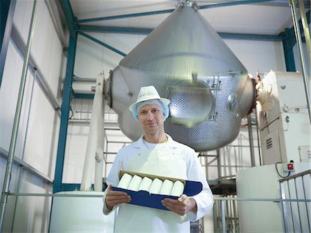 food processing plant - Worker holding goat's butter in dairy Stock Photo - Premium Royalty-Free, Code: 649-03883761