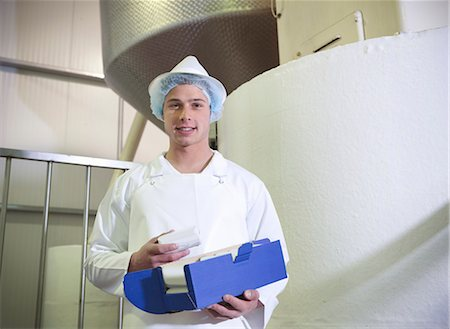 food processing plant - Worker holding goat's butter in dairy Stock Photo - Premium Royalty-Free, Code: 649-03883762
