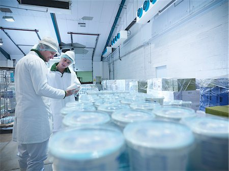 food processing plant - Workers with yogurt in dairy cold store Stock Photo - Premium Royalty-Free, Code: 649-03883774