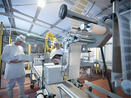 food processing plant - Worker packing boxes in dairy Stock Photo - Premium Royalty-Free, Code: 649-03883772