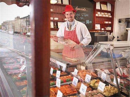 Butcher holding leg of lamb in shop Stock Photo - Premium Royalty-Free, Code: 649-03883827
