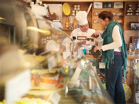 Baker with customer in cake shop Stock Photo - Premium Royalty-Free, Code: 649-03883822