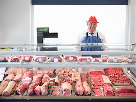 Butcher standing behind meat counter Stock Photo - Premium Royalty-Free, Code: 649-03883830