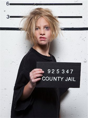 Studio mugshot of girl (8-9) with tousled hair Stock Photo - Premium Royalty-Free, Code: 640-05760909