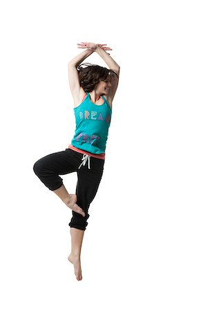 Woman exercising standing on one leg Stock Photo - Premium Royalty-Free, Code: 640-05761020
