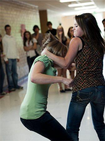 student fighting - USA, Utah, Spanish Fork, Two girls (14-17) fighting in school corridor Stock Photo - Premium Royalty-Free, Code: 640-05761061