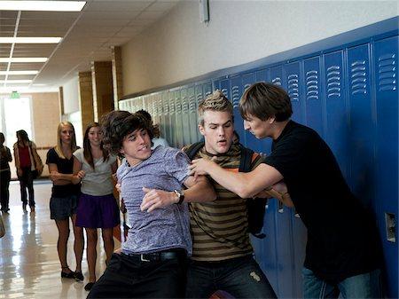 student fighting - USA, Utah, Spanish Fork, Three boys (16-17) fighting in school corridor Stock Photo - Premium Royalty-Free, Code: 640-05761062