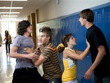 student fighting - USA, Utah, Spanish Fork, Four school children (16-17) fighting in school corridor Stock Photo - Premium Royalty-Free, Code: 640-05761063