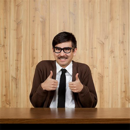 filipino (male) - Portrait of businessman giving thumbs up Stock Photo - Premium Royalty-Free, Code: 640-05761171