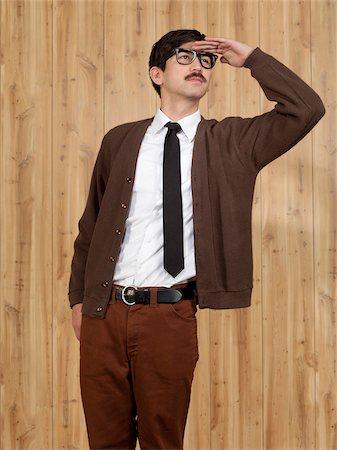 filipino (male) - Successful businessman saluting in office Stock Photo - Premium Royalty-Free, Code: 640-05761189
