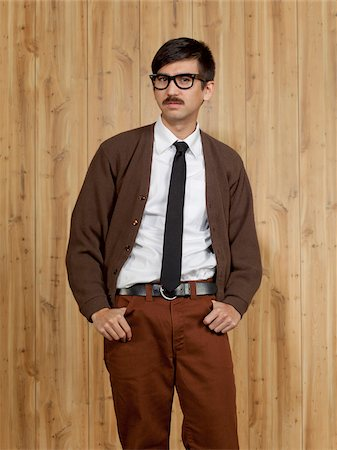 filipino (male) - Studio portrait of successful businessman Stock Photo - Premium Royalty-Free, Code: 640-05761190