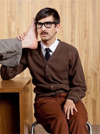 filipino (male) - Businessman using foot phone in office Stock Photo - Premium Royalty-Free, Code: 640-05761205