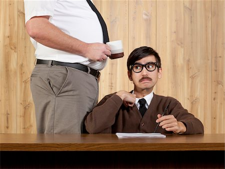 filipino (male) - Boss by stressed businessman at desk in office Stock Photo - Premium Royalty-Free, Code: 640-05761200