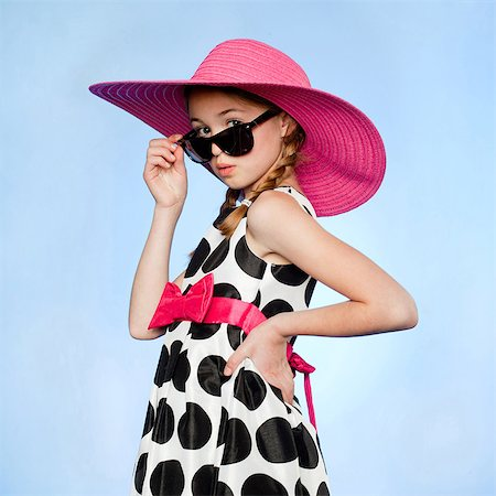 polka dot - Studio portrait of elegant girl (10-11) wearing hat, sunglasses and dress Stock Photo - Premium Royalty-Free, Code: 640-05761293