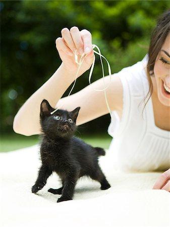 USA, Utah, Orem, Woman playing with kitten Stock Photo - Premium Royalty-Free, Code: 640-05761407