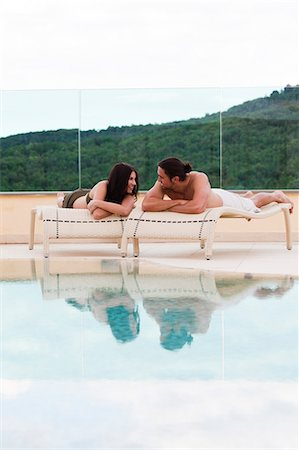 desire - Italy, Young couple relaxing by swimming pool Stock Photo - Premium Royalty-Free, Code: 640-06049891