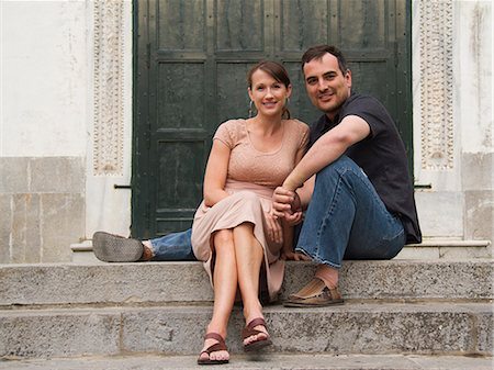 Italy, Ravello, Couple sitting on stairs Stock Photo - Premium Royalty-Free, Code: 640-06050017