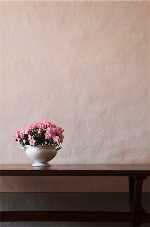 Italy, Tuscany, Pink flowers in vase on table Stock Photo - Premium Royalty-Free, Code: 640-06050059