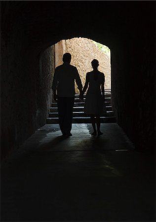 Italy, Ravello, Mature couple walking in dark archway Stock Photo - Premium Royalty-Free, Code: 640-06050104