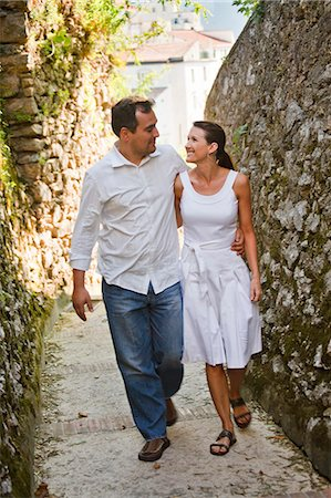 Italy, Ravello, Mature couple walking along narrow lane Stock Photo - Premium Royalty-Free, Code: 640-06050116