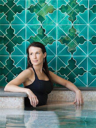 Italy, Amalfi Coast, Ravello, Mature woman in swimming pool looking away Stock Photo - Premium Royalty-Free, Code: 640-06050139
