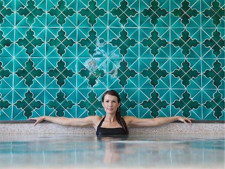 Italy, Amalfi Coast, Ravello, Portrait of mature woman in swimming pool Stock Photo - Premium Royalty-Free, Code: 640-06050142