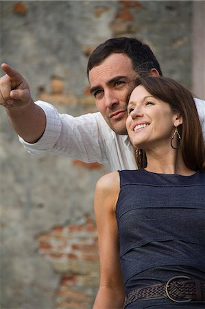 Italy, Venice, Mature couple looking away, man is pointing Stock Photo - Premium Royalty-Free, Code: 640-06050177