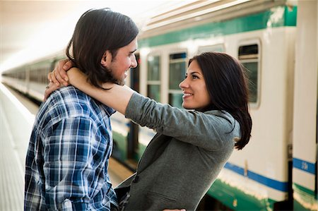Italy, Venice, Young couple embracing on railway station Stock Photo - Premium Royalty-Free, Code: 640-06050244