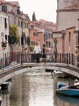 european (places and things) - Italy, Venice, Romantic couple walking on footbridge over canal Stock Photo - Premium Royalty-Free, Code: 640-06050341