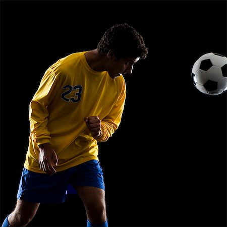 soccer player heading the ball Stock Photo - Premium Royalty-Free, Code: 640-06050644