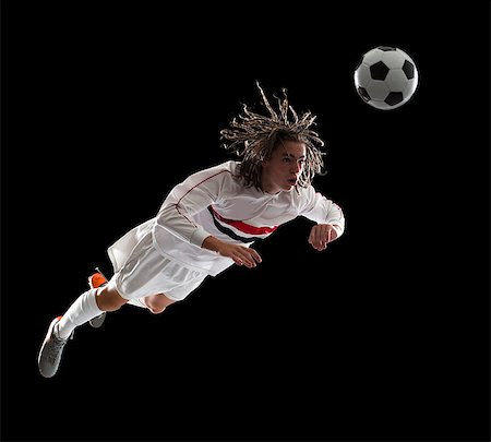 Soccer player heading the ball Stock Photo - Premium Royalty-Free, Code: 640-06050648