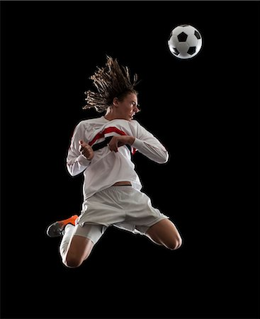 soccer player heading the ball Stock Photo - Premium Royalty-Free, Code: 640-06050641