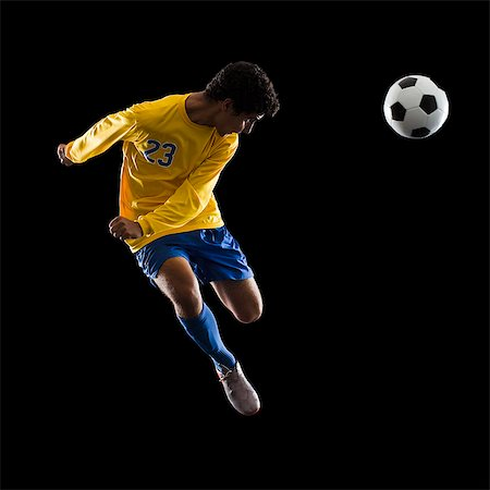 soccer player heading the ball Stock Photo - Premium Royalty-Free, Code: 640-06050642
