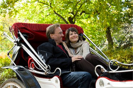 USA, New York City, Manhattan, Central Park, Mature couple in carriage in Central Park Stock Photo - Premium Royalty-Free, Code: 640-06050697