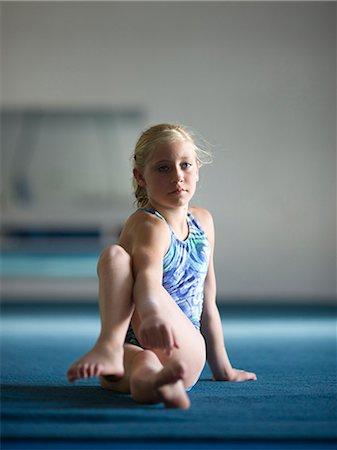 preteen girls stretching - USA, Utah, Orem, Girl (10-11) stretching in gym Stock Photo - Premium Royalty-Free, Code: 640-06050725
